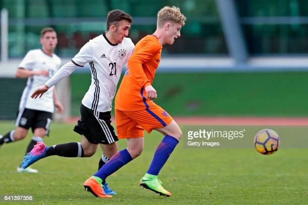 Erkan Eyibil of Germany U16 challenges Vincent Schippers of Netherlands U16 during the UEFA Development Tournament Match between Germany U16 and...