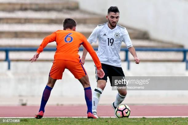 Erkan Eyibil of Germany U17 chalenges Bram Franken of Netherlands U17 during U17Juniors Algarve Cup match between U17 Netherlands and U17 Germany at...