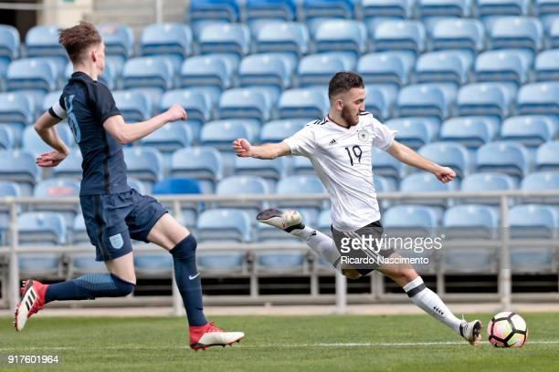 Erkan Eyibil of Germany U17 chalenges Jimmy Garner of England U17 during U17Juniors Algarve Cup match between U17 Germany and U17 England at Algarve...