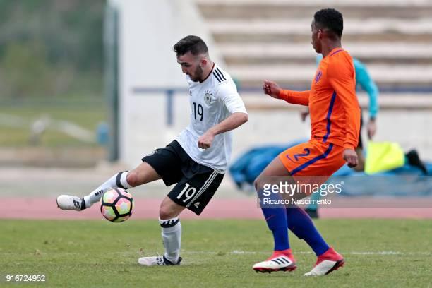 Erkan Eyibil of Germany U17 chalenges Jurrien Maduro of Netherlands U17 during U17Juniors Algarve Cup match between U17 Netherlands and U17 Germany...