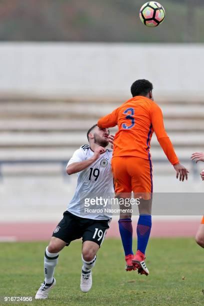 Erkan Eyibil of Germany U17 chalenges Shurandy Sambo of Netherlands U17 during U17Juniors Algarve Cup match between U17 Netherlands and U17 Germany...