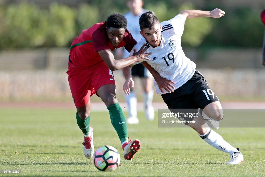 Erkan Eyibil (R) of Germany U17 challenges Levi Faustino (L) of Portugal U17 during U17-Juniors Algarve Cup match between U17 Portugal and U17 Germany at Bela Vista Stadium on February 13, 2018 in Parchal, Portugal.