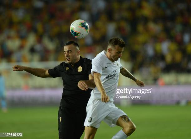 Erkan Kas of Yeni Malatyaspor in action against Samardzic of Olimpija Ljubljana during the UEFA Europa League second qualifying match between Yeni...