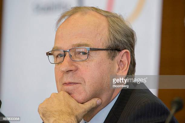 Erkki Liikanen governor of the Bank of Finland pauses as he addresses the European Central Bank and its watchers conference in Frankfurt Germany on...