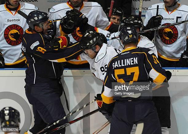Erkki Rajamaki and Tomi Sallinen of Espoo Blues and Christian Dube of Bern fight during the IIHF Champions Hockey League match between Espoo Blues...