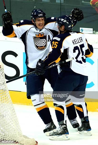 Erkki Rajamaki of Espoo celebrates scoring the second goal with team mate Ryan Keller during the IIHF Champions Hockey League match between SC Bern...