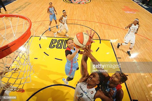 Erlana Larkins of the Indiana Fever battles Angel McCoughtry of the Atlanta Dream in game two of the WNBA Eastern Conference Finals on September 29...