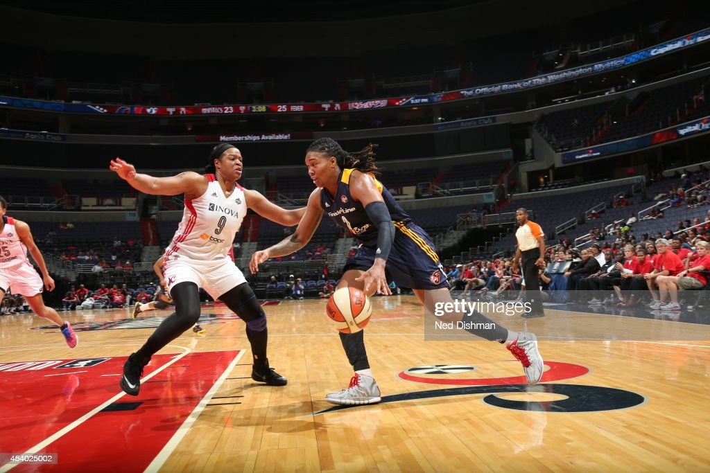 Erlana Larkins #2 of the Indiana Fever drives against Kia Vaughn #9 of the Washington Mystics in Game Two of the Eastern Conference Semifinals during the 2014 WNBA Playoffs on August 23, 2014 at the Verizon Center in Washington, DC.