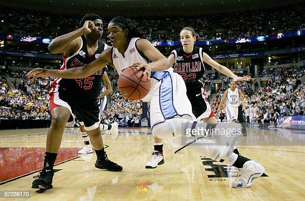 Erlana Larkins of the North Carolina Tar Heels tries to dribble around Jade Perry and Shay Doron both of the Maryland Terrapins during the 2006...