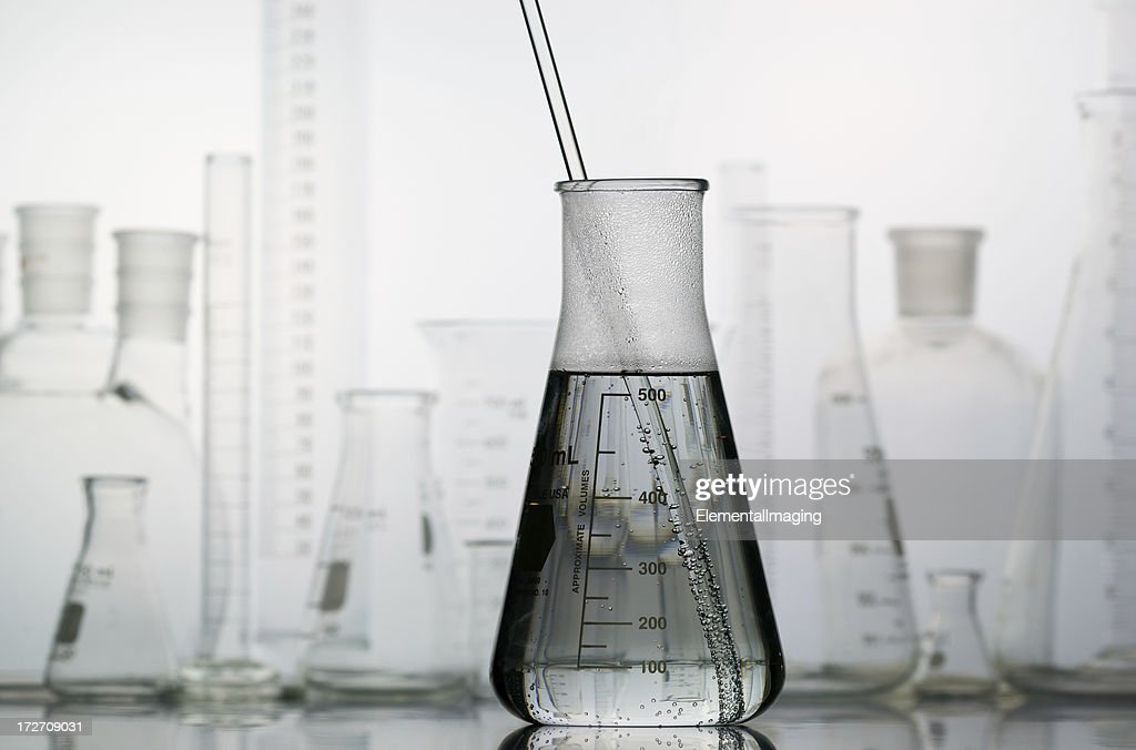 Erlenmeyer Flask with Laboratory Glassware in the Background : Stock Photo