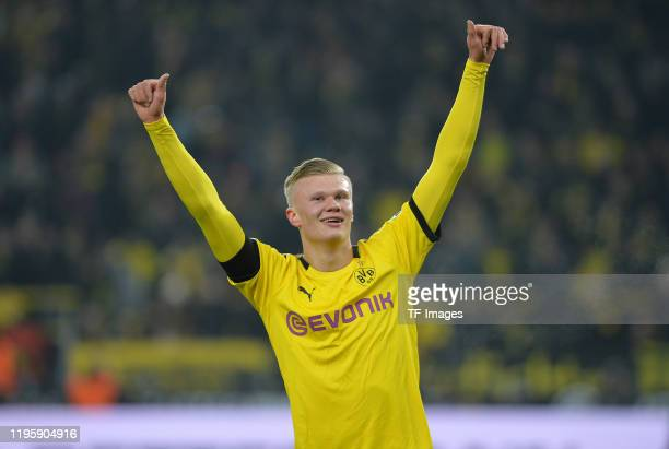 Erling Braut Haaland of Borussia Dortmund celebrates after scoring his teams fifth goal with the team mates during the Bundesliga match between...