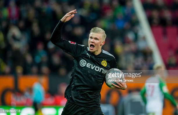 Erling Braut Haaland of Borussia Dortmund celebrates his goal to the 32 during the Bundesliga match between FC Augsburg and Borussia Dortmund at the...