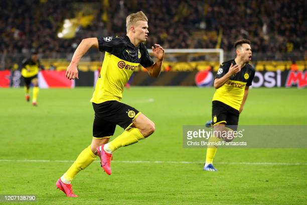 Erling Braut Haaland of Borussia Dortmund celebrates scoring his side's second goal during the UEFA Champions League round of 16 first leg match...