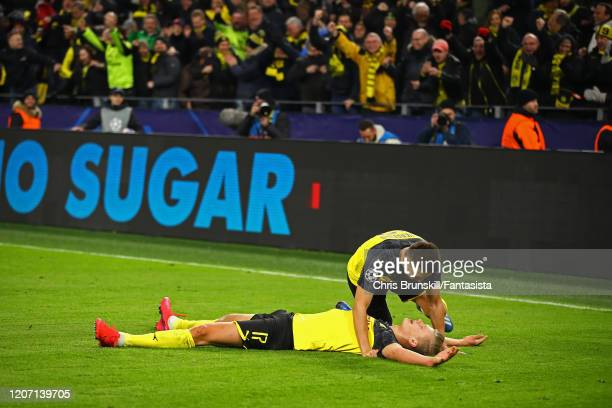 Erling Braut Haaland of Borussia Dortmund celebrates scoring his side's second goal with teammate Raphael Guerreiro during the UEFA Champions League...
