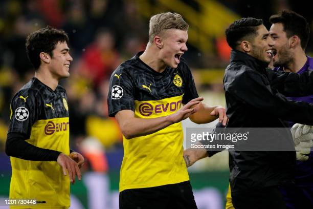 Erling Braut Haaland of Borussia Dortmund celebrates the victory with Julian Weigl of Borussia Dortmund Roman Burki of Borussia Dortmund Achraf...