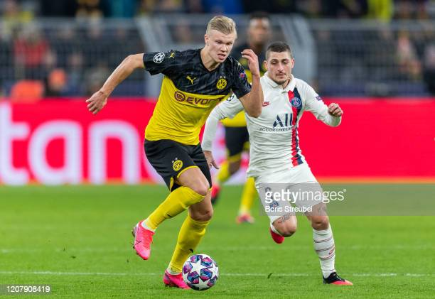 Erling Braut Haaland of Borussia Dortmund is challenged by Marco Verratti of Paris SaintGermain during the UEFA Champions League round of 16 first...