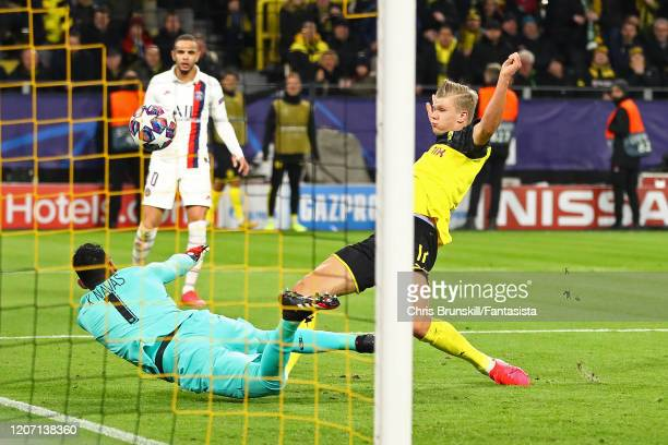 Erling Braut Haaland of Borussia Dortmund scores the opening goal during the UEFA Champions League round of 16 first leg match between Borussia...