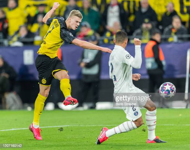 Erling Braut Haaland of Borussia Dortmund takes a shot during the UEFA Champions League round of 16 first leg match between Borussia Dortmund and...