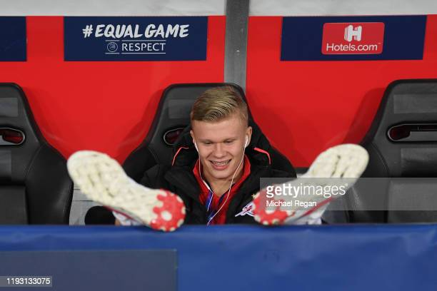 Erling Braut Haaland of RB Salzburg looks on from the bench as players inspect the pitch ahead of the UEFA Champions League group E match between RB...
