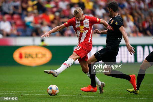 Erling Braut Haland of RB Salzburg and Christoph Schoesswendter of Admira during the tipico Bundesliga match between FC Red Bull Salzburg and FC...