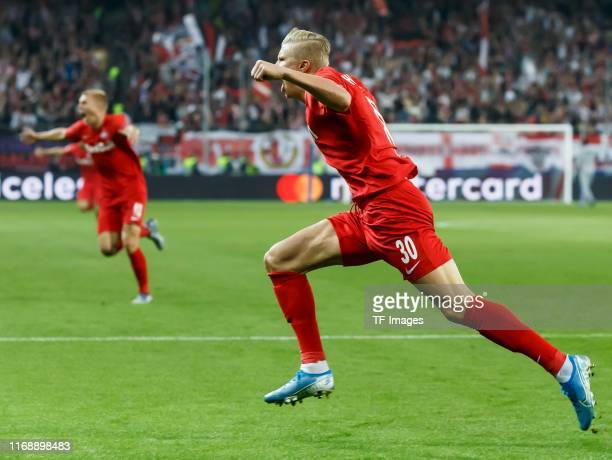 Erling Braut Haland of RB Salzburg celebrates after scoring his team's first goal during the UEFA Champions League group E match between RB Salzburg...