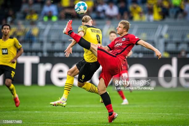 Erling Haaland and Martin Hinteregger of Frankfurt in action during the Bundesliga match between Borussia Dortmund and Eintracht Frankfurt at Signal...