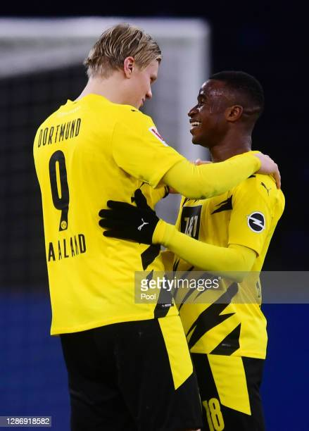 Erling Haaland and Youssoufa Moukoko of Dortmund chat after the Bundesliga match between Hertha BSC and Borussia Dortmund at Olympiastadion on...