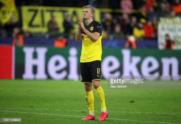Erling Haaland of Borussia Dortmund acknowledges the fans after the UEFA Champions League round of 16 first leg match between Borussia Dortmund and...