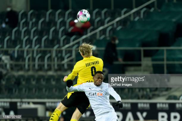 Erling Haaland of Borussia Dortmund and Denis Zakaria of Borussia Moenchengladbach battle for the ball during the Bundesliga match between Borussia...