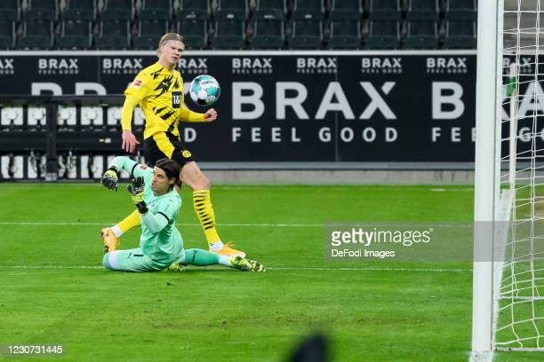Erling Haaland of Borussia Dortmund and goalkeeper Yann Sommer of Borussia Moenchengladbach scores his team's first goal during the Bundesliga match...