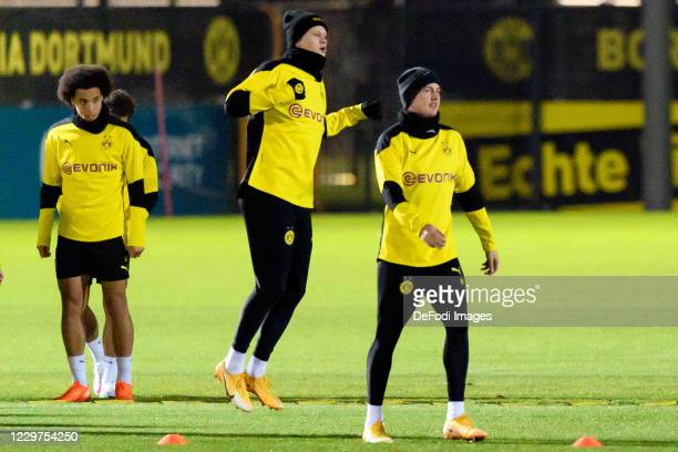 Erling Haaland of Borussia Dortmund and Julian Brandt of Borussia Dortmund look on ahead of the UEFA Champions League Group F stage match between...