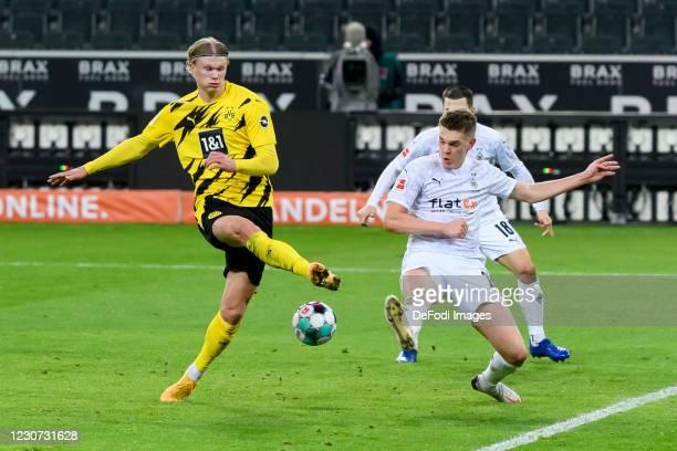 Erling Haaland of Borussia Dortmund and Matthias Ginter of Borussia Moenchengladbach battle for the ball during the Bundesliga match between Borussia...