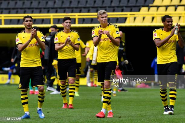 Erling Haaland of Borussia Dortmund and teammates celebrate following the Bundesliga match between Borussia Dortmund and FC Schalke 04 at Signal...