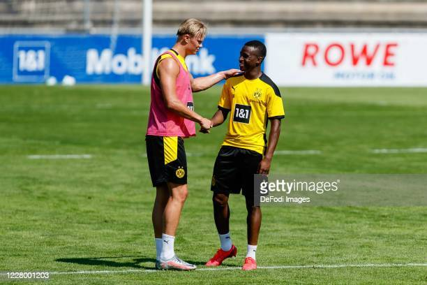 Erling Haaland of Borussia Dortmund and Youssoufa Moukoko of Borussia Dortmund look on during day 2 of the pre-season summer training camp of...