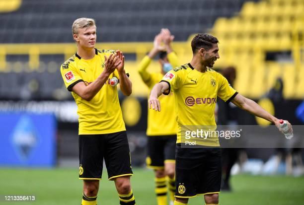 Erling Haaland of Borussia Dortmund applauds the empty tribune following victory in the Bundesliga match between Borussia Dortmund and FC Schalke 04...