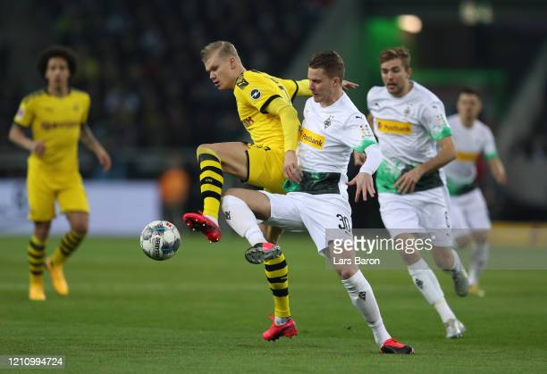 Erling Haaland of Borussia Dortmund battles for possession with Nico Elvedi of Borussia Moenchengladbach during the Bundesliga match between Borussia...