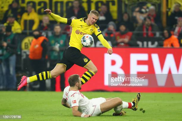 Erling Haaland of Borussia Dortmund battles for possession with Rafael Czichos of 1. FC Koeln during the Bundesliga match between Borussia Dortmund...
