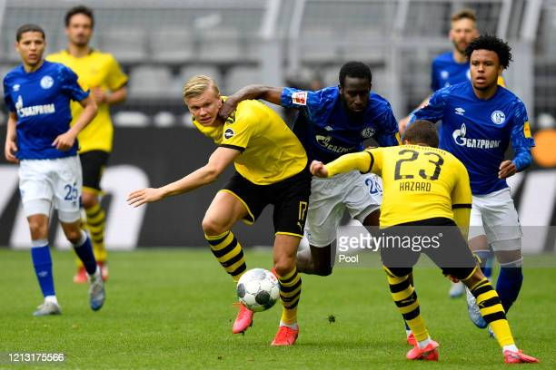 Erling Haaland of Borussia Dortmund battles for the ball with Salif Sane of FC Schalke 04 during the Bundesliga match between Borussia Dortmund and...