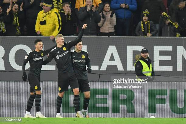 Erling Haaland of Borussia Dortmund celebrates after scoring his team's fifth goal with teammates Jadon Sancho during the Bundesliga match between FC...