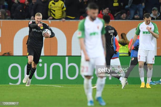 Erling Haaland of Borussia Dortmund celebrates after scoring his team's second goal during the Bundesliga match between FC Augsburg and Borussia...