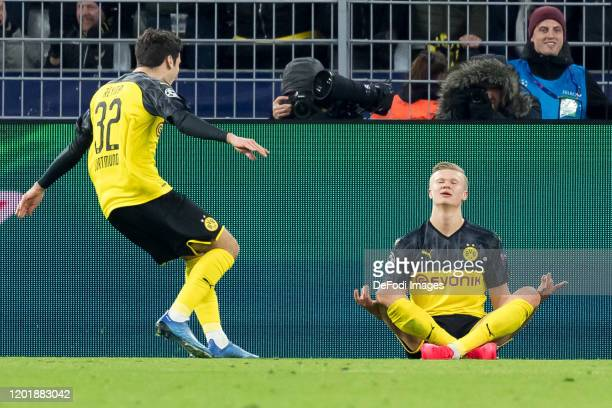 Erling Haaland of Borussia Dortmund celebrates after scoring his team's first goal during the UEFA Champions League round of 16 first leg match...