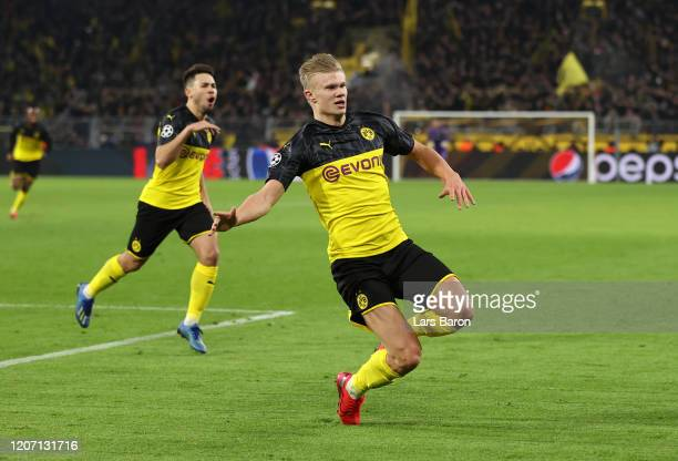 Erling Haaland of Borussia Dortmund celebrates after scoring his team's second goal during the UEFA Champions League round of 16 first leg match...
