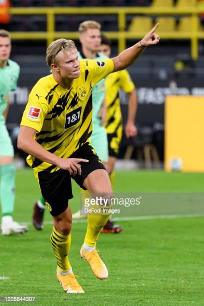 Erling Haaland of Borussia Dortmund celebrates after scoring his team's third goal during the Bundesliga match between Borussia Dortmund and Borussia...