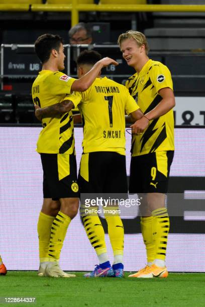 Erling Haaland of Borussia Dortmund celebrates after scoring his team's second goal with teammates during the Bundesliga match between Borussia...