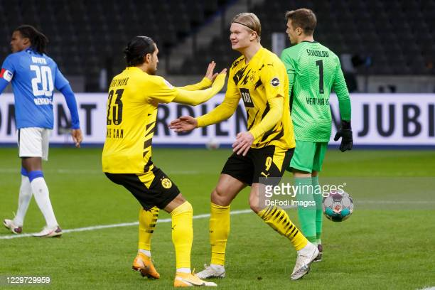 Erling Haaland of Borussia Dortmund celebrates after scoring his team's first goal with teammates during the Bundesliga match between Hertha BSC and...