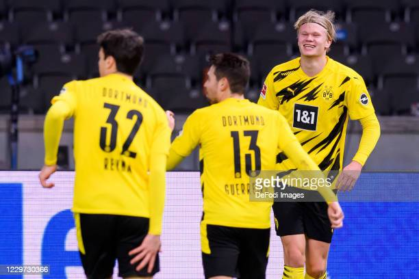 Erling Haaland of Borussia Dortmund celebrates after scoring his team's fifth goal with teammates during the Bundesliga match between Hertha BSC and...