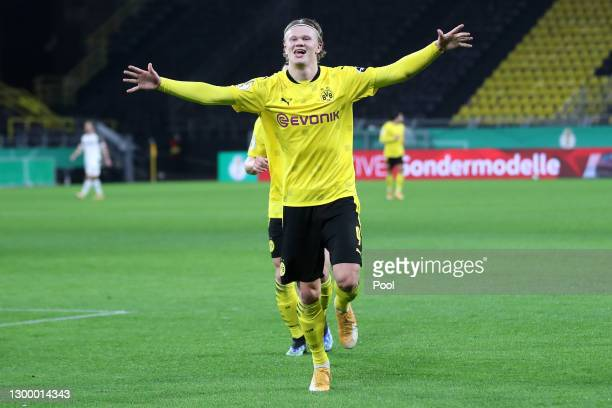 Erling Haaland of Borussia Dortmund celebrates after scoring their side's third goal during the DFB Cup Round of Sixteen match between Borussia...