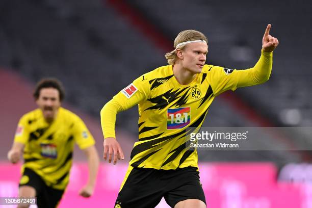 Erling Haaland of Borussia Dortmund celebrates after scoring their team's first goal during the Bundesliga match between FC Bayern Muenchen and...