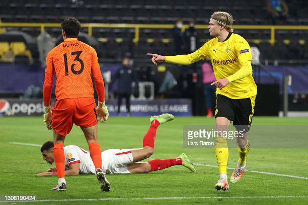 Erling Haaland of Borussia Dortmund celebrates after scoring their side's first goal during the UEFA Champions League Round of 16 match between...