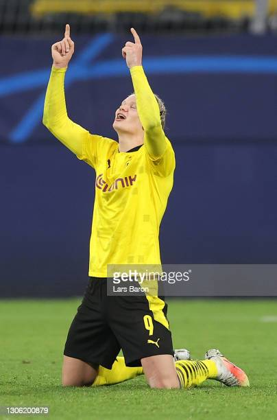 Erling Haaland of Borussia Dortmund celebrates his side's victory after the UEFA Champions League Round of 16 match between Borussia Dortmund and...